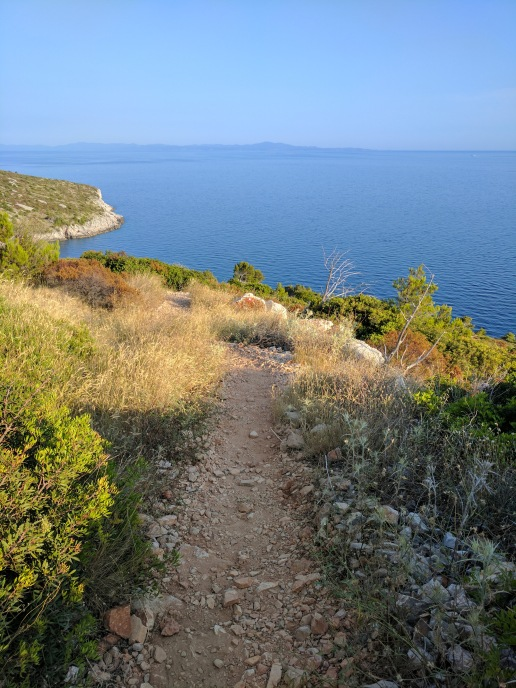 Walking down a mountain to reach the bay